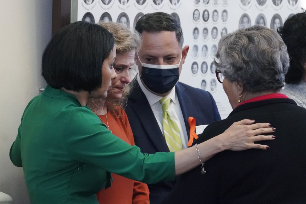 Texas State Rep. Donna Howard, D-Austin, second from left, talks with fellow lawmakers in the House Chamber, Wednesday, May 5, 2021, in Austin, Texas,...