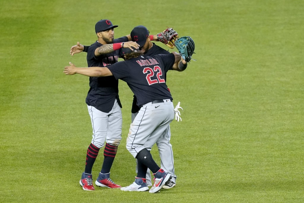 Cleveland Indians outfielders celebrate after their baseball game against the Kansas City Royals Wednesday, May 5, 2021, in Kansas City, Mo. The India...