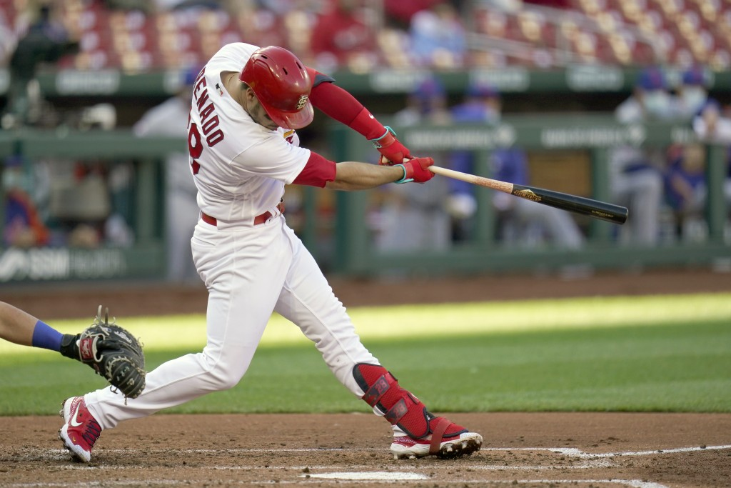 St. Louis Cardinals' Nolan Arenado hits an RBI single during the third inning in the first game of a baseball doubleheader against the New York Mets W...
