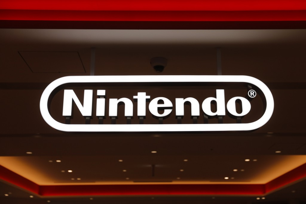 FILE - In this Jan. 23, 2020, file photo, a Nintendo sign is seen at the company's official store in the Shibuya district of Tokyo. Nintendo Co.'s pro...