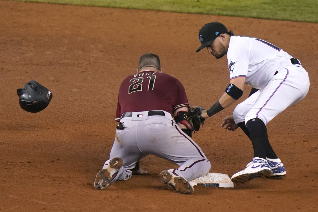 Arizona Diamondbacks' Stephen Vogt (21) loses his helmet as he is safe at second with a double during the of a baseball game, Wednesday, May 5, 2021, ...