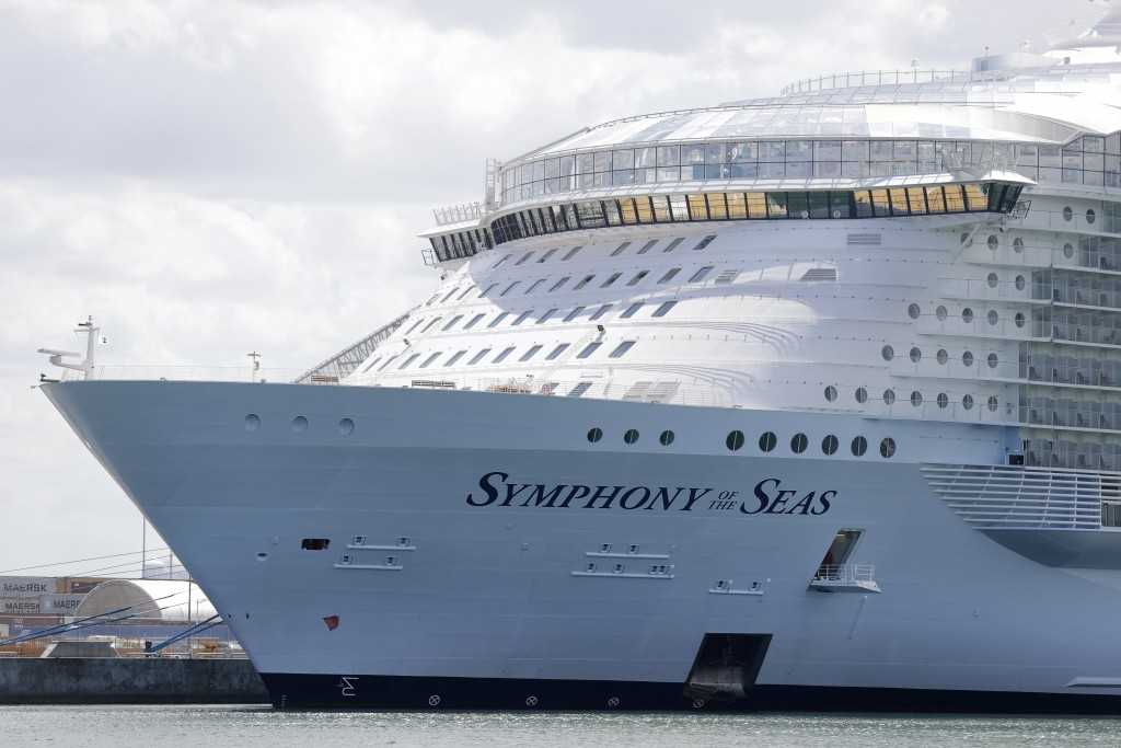 FILE - The Symphony of the Seas cruise ship is shown docked at PortMiami, in a Wednesday, May 20, 2020, file photo, in Miami. Cruise lines can soon be...