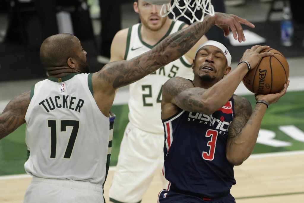 Washington Wizards' Bradley Beal (3) is fouled by Milwaukee Bucks' P.J. Tucker (17) during the first half of an NBA basketball game Wednesday, May 5, ...