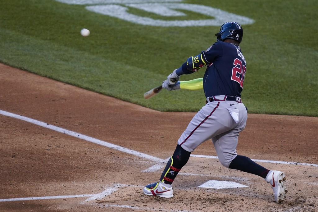 Atlanta Braves' Marcell Ozuna hits a grand slam during the third inning of the team's baseball game against the Washington Nationals at Nationals Park...