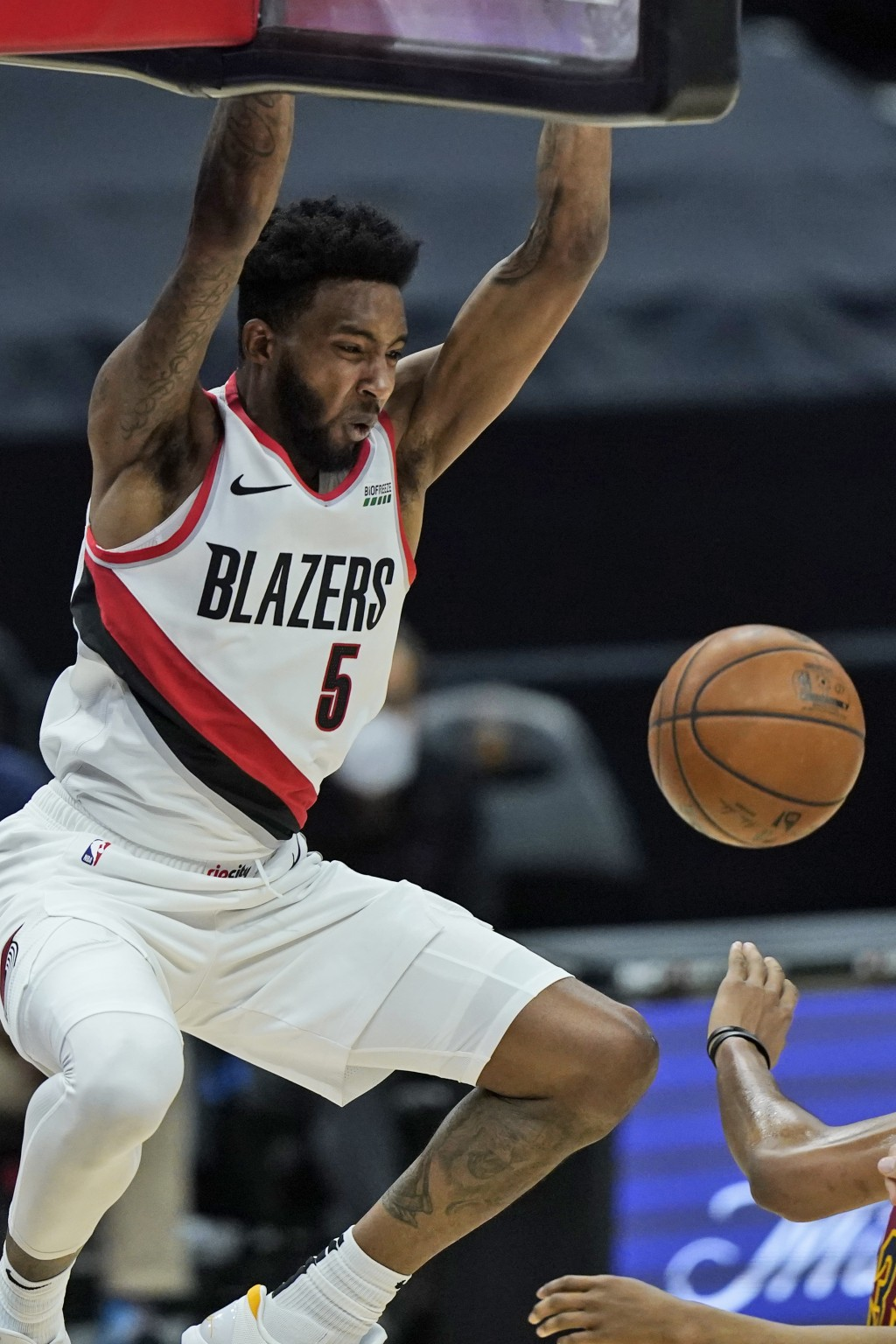 Portland Trail Blazers' Derrick Jones Jr. dunks during the second half of the team's NBA basketball game against the Cleveland Cavaliers, Wednesday, M...