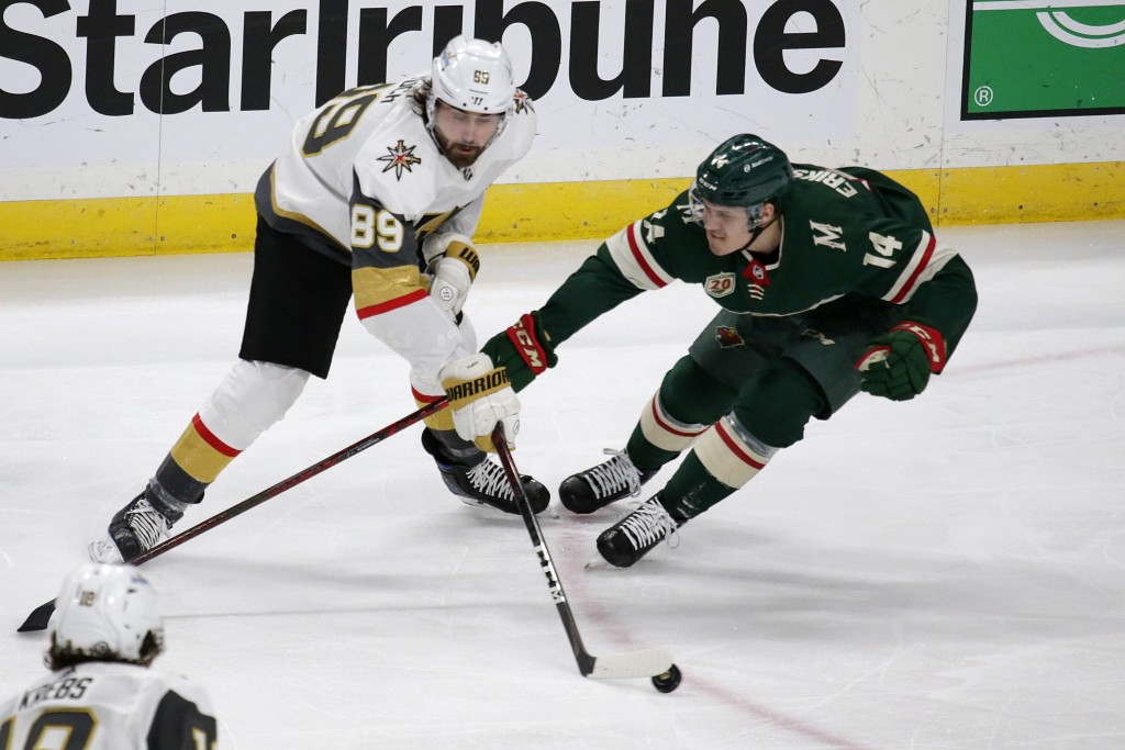 Vegas Golden Knights right wing Alex Tuch (89) controls the puck as Minnesota Wild center Joel Eriksson Ek (14) defends during the first period of an ...