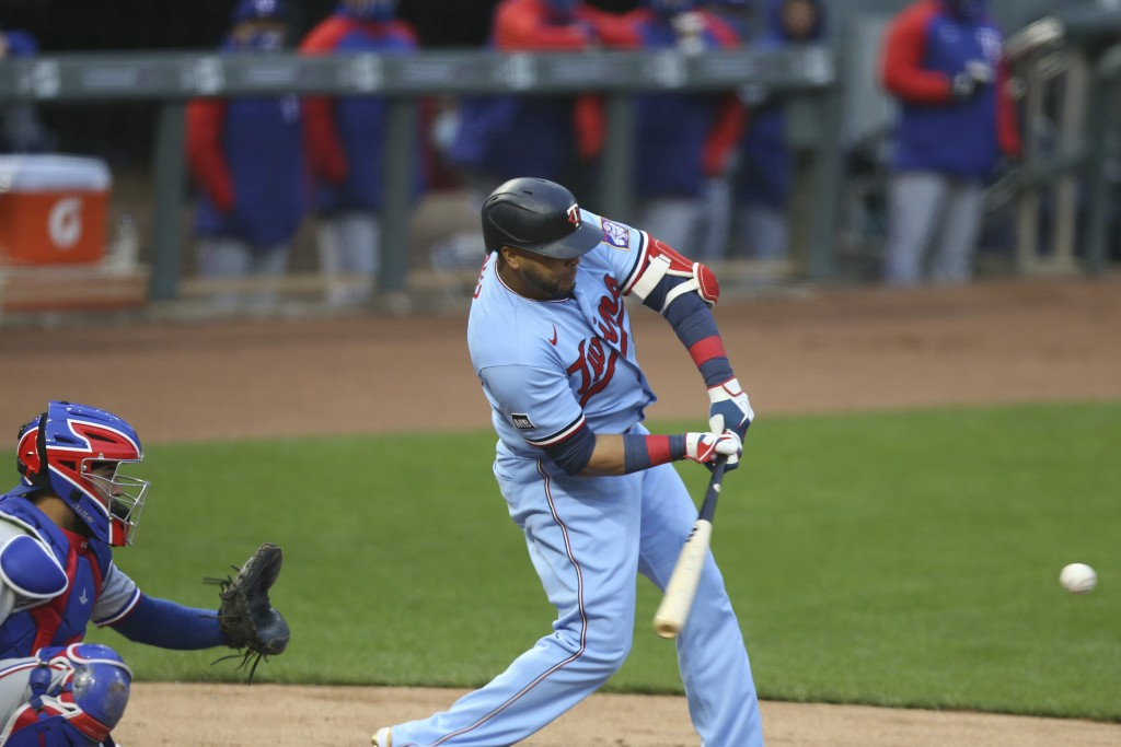 Minnesota Twins' Nelson Cruz strikes out against the Texas Rangers during the first inning of a baseball game Wednesday, May 5, 2021, in Minneapolis. ...