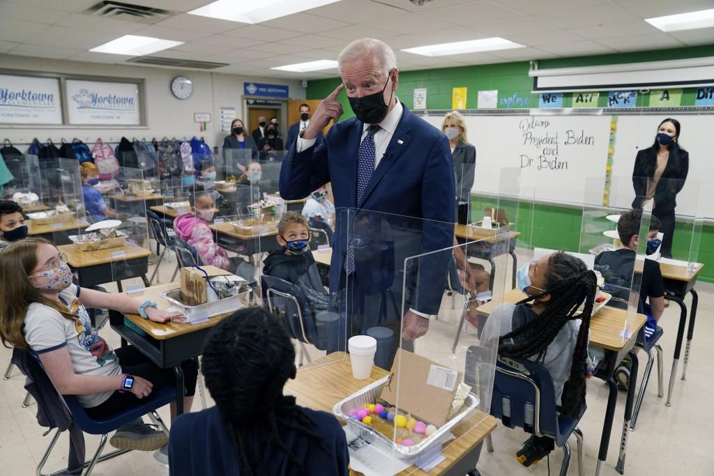 In this May 3, 2021, photo, President Joe Biden gestures as he talks to students during a visit to Yorktown Elementary School, in Yorktown, Va., as fi...