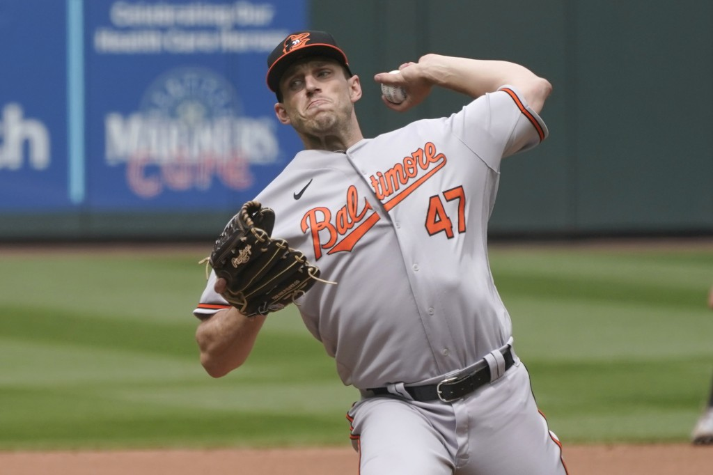 Baltimore Orioles starting pitcher John Means throws against the Seattle Mariners during the seventh inning of a baseball game, Wednesday, May 5, 2021...