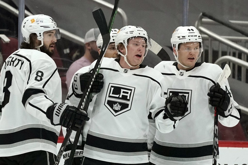 Los Angeles Kings center Jaret Anderson-Dolan, middle, celebrates his goal against the Arizona Coyotes with teammates, including defensemen Drew Dough...