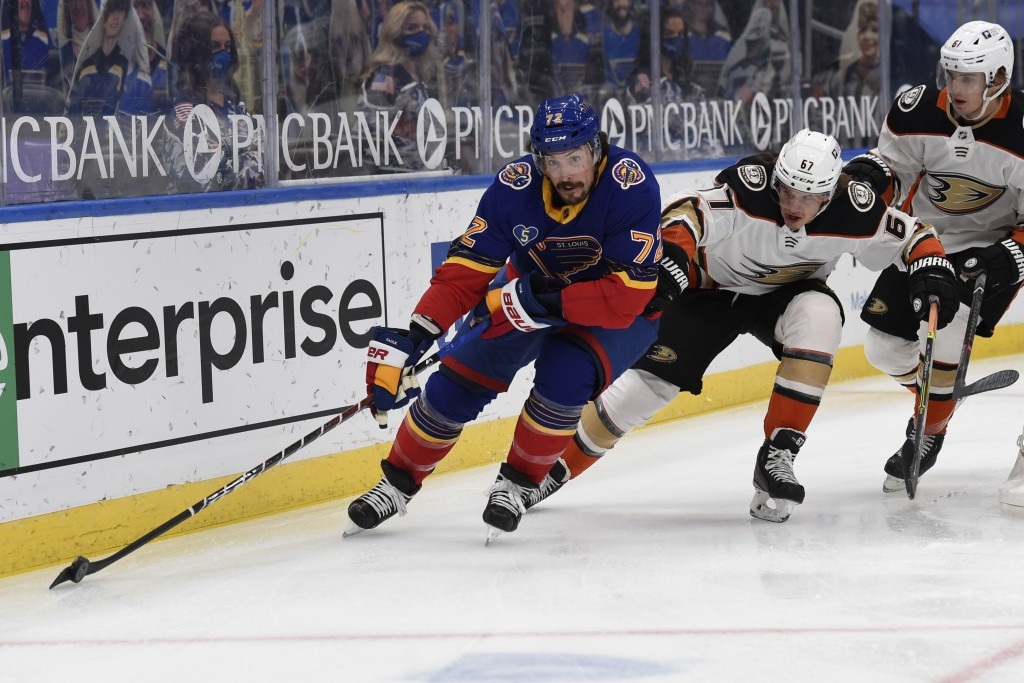 Anaheim Ducks' Rickard Rakell (67) pressures St. Louis Blues' Justin Faulk (72) during the first period of an NHL hockey game on Wednesday, May 5, 202...
