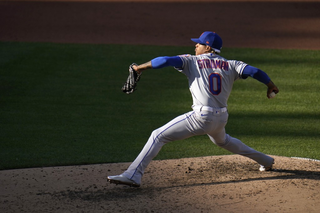 New York Mets starting pitcher Marcus Stroman throws during the fourth inning in the first game of a baseball doubleheader against the St. Louis Cardi...