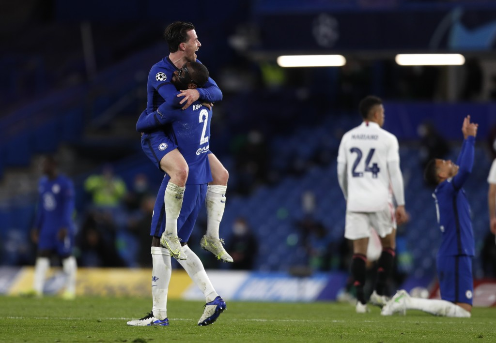 Chelsea's Ben Chilwell, left, celebrates with his teammate Antonio Rudiger at the end of the Champions League semifinal 2nd leg soccer match between C...