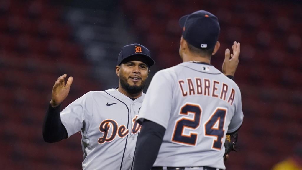 Detroit Tigers third baseman Jeimer Candelario, left, is congratulated by Miguel Cabrera (24) after the Tigers defeated the Boston Red Sox 6-5 in a ba...
