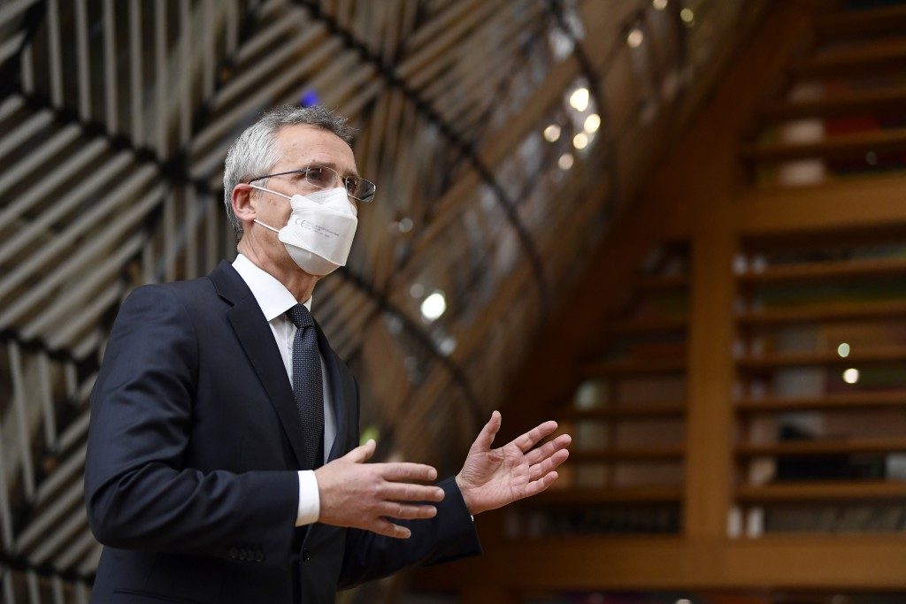 NATO Secretary General Jens Stoltenberg makes a statement to the media as he arrives for a meeting of EU defense ministers at the European Council bui...