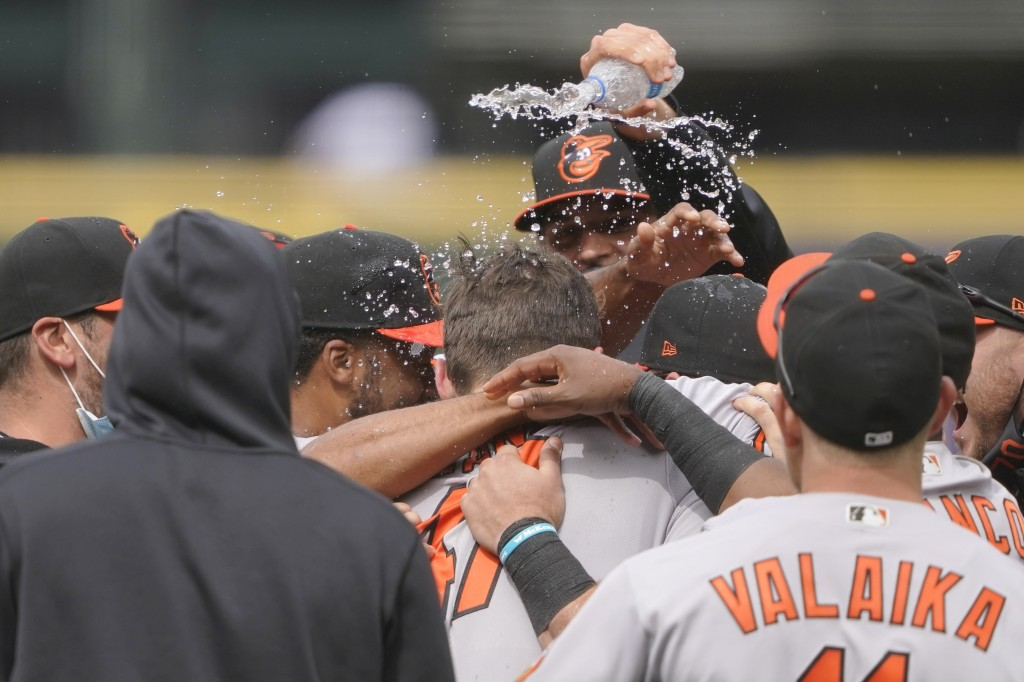 Baltimore Orioles starting pitcher John Means is mobbed by teammates and has water dumped on him after he threw a no-hitter baseball game against the ...