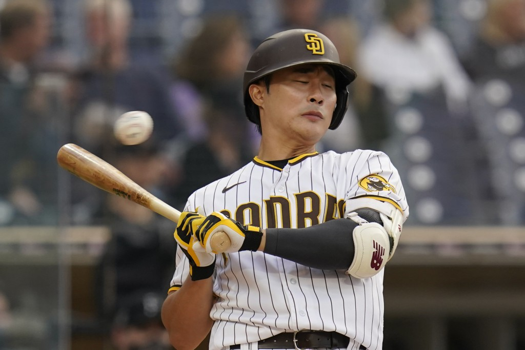 San Diego Padres' Ha-Seong Kim moves back from an inside pitch while batting during the fourth inning of the team's baseball game against the Pittsbur...
