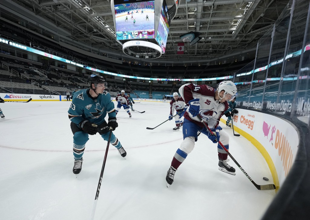 Colorado Avalanche center Carl Soderberg (34) moves the puck past San Jose Sharks defenseman Nicolas Meloche (53) during the second period of an NHL h...