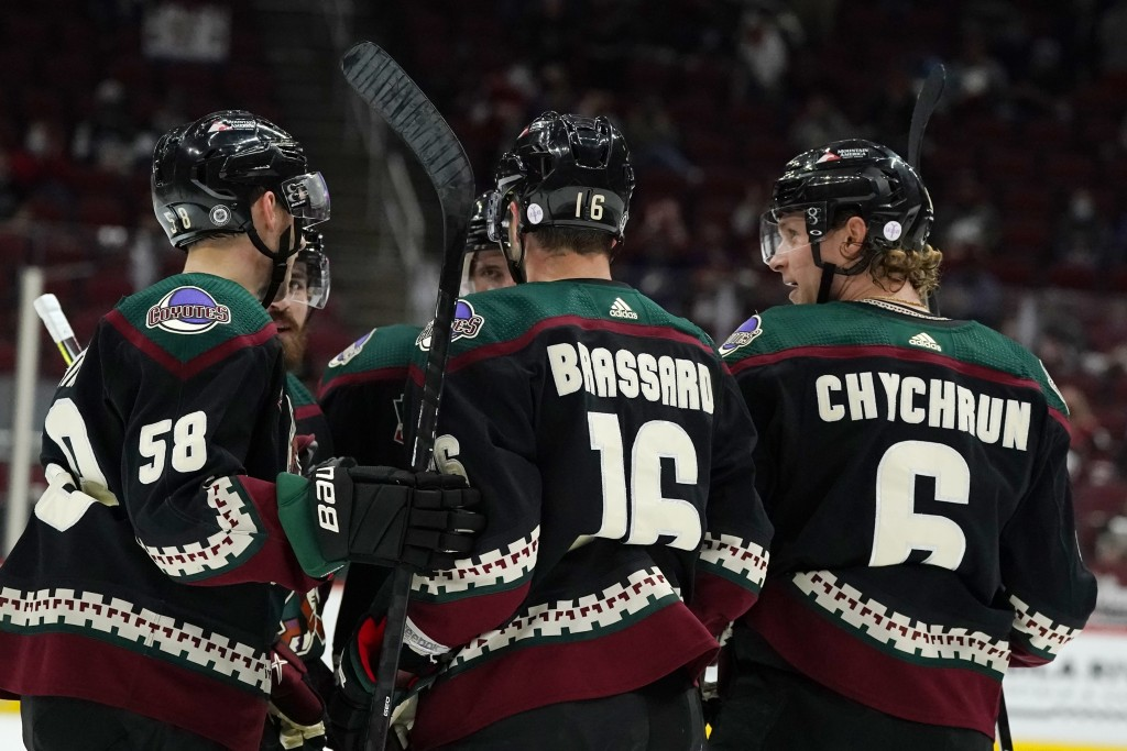 Arizona Coyotes defenseman Jakob Chychrun (6) celebrates his goal against the Los Angeles Kings with teammates, including left wing Michael Bunting (5...