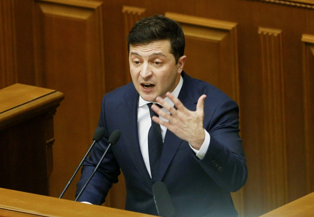 FILE - In this Wednesday, March 4, 2020 file photo, Ukrainian President Volodymyr Zelenskyy gestures as he addresses the Ukrainian parliament in Kyiv,...