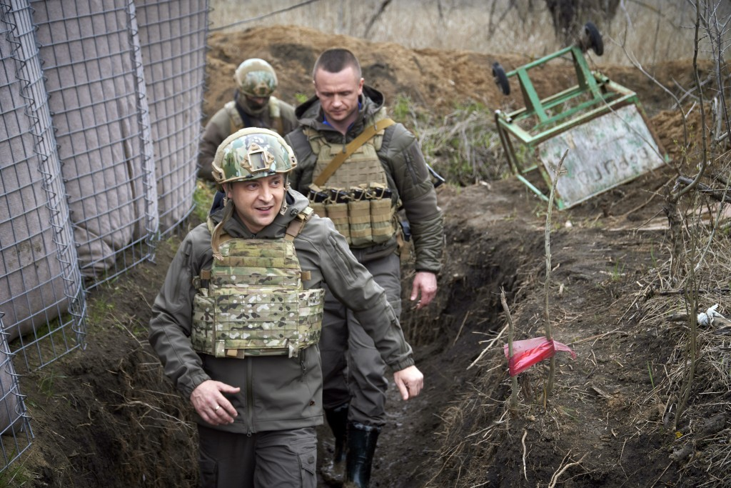 FILE - In this April 9, 2021 file photo, Ukrainian President Volodymyr Zelenskyy visits the war-hit Donbas region, eastern Ukraine. Ukrainians hold st...