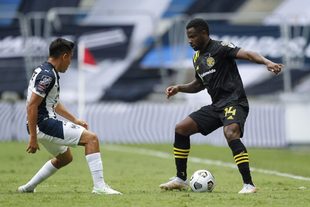 Waylon Francis of Unites States' Columbus Crew is challenged by Sebastian Vegas of Mexico's Monterrey during a Concacaf Champions League soccer game i...