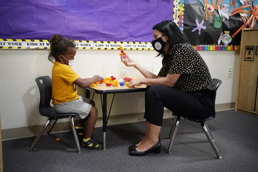 Teacher Juliana Urtubey, right, interacts with Kamari Wolfe in a class at Kermit R Booker Sr Elementary School Wednesday, May 5, 2021, in Las Vegas. U...