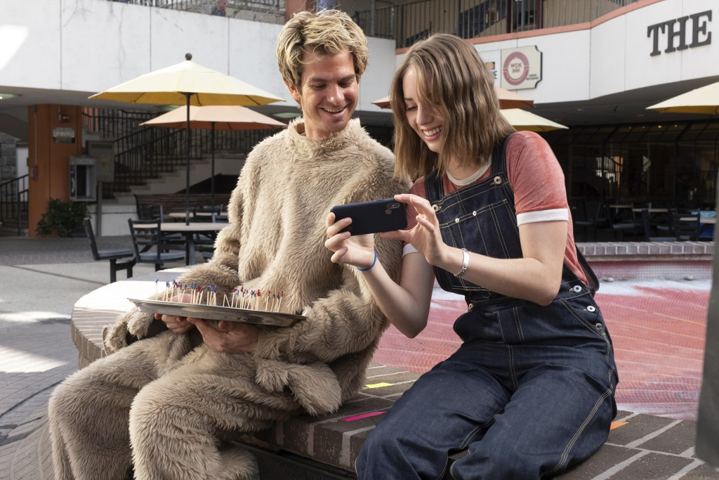 """This image released by IFC Films shows Andrew Garfield, left, and Maya Hawke in a scene from """"Mainstream,"""" a film by Gia Coppola. (Beth Dubber/IFC Fil..."""