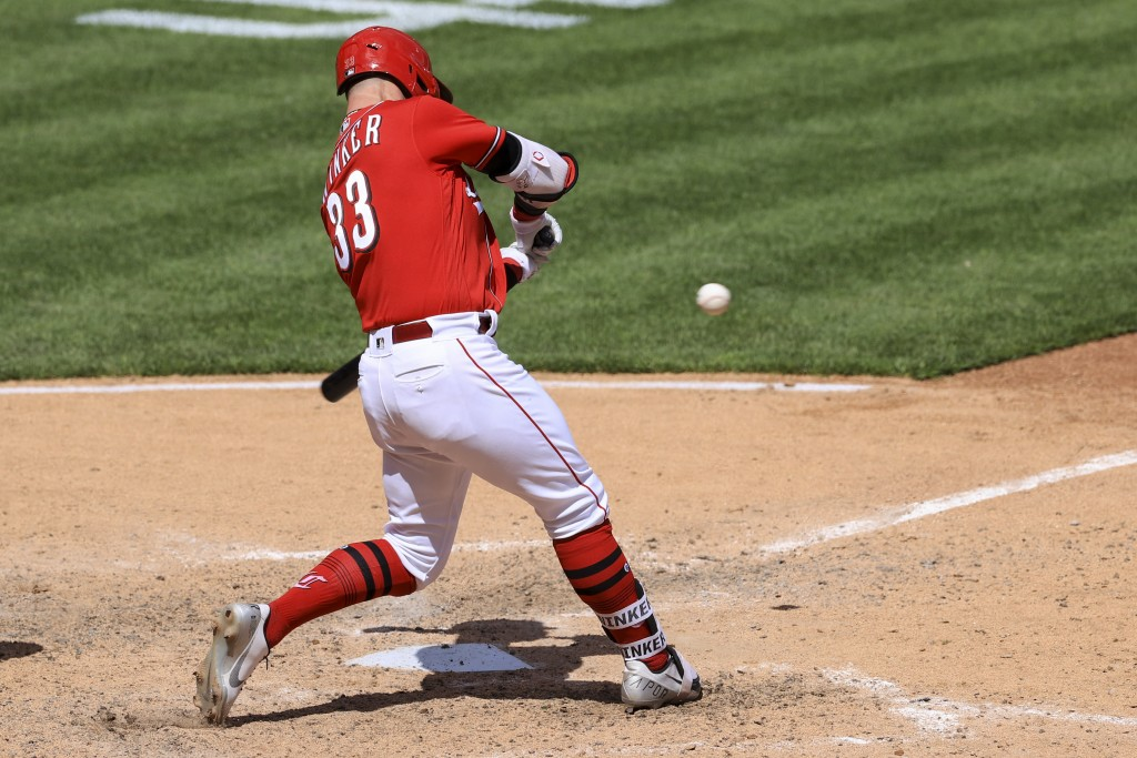 Cincinnati Reds' Jesse Winker hits an RBI walk-off single during the tenth inning of a baseball game against the Chicago White Sox in Cincinnati, Wedn...