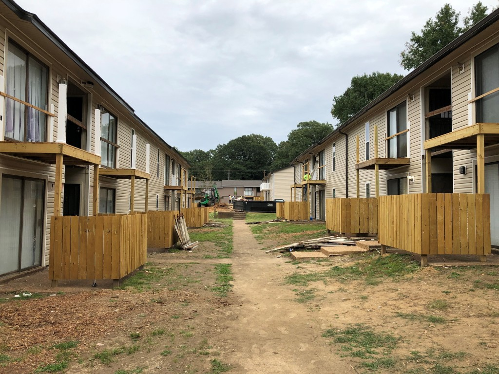 FILE - In this Sept. 22, 2020, file photo buildings at Hunter Oaks Apartments undergo renovations in Memphis, Tenn. Owners of the apartment complex ar...