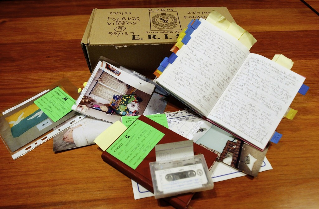 Evidence including a diary belonging to Kathleen Folbigg is displayed on a table in Sydney on May 22, 2003. Nearly two decades after Folbigg was convi...