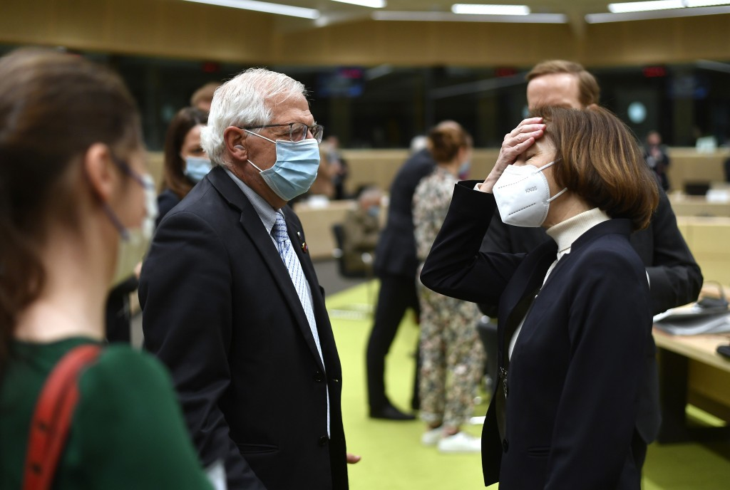 European Union foreign policy chief Josep Borrell, left, speaks with French Defense Minister Florence Parly, right, during a meeting of EU defense min...