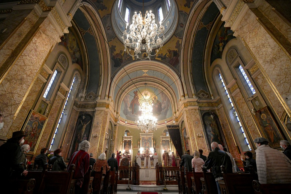 Members of the Armenian community in Romania, attend the Easter religious service, at the Armenian Church in Bucharest, Romania, Saturday, May 1, 2021...