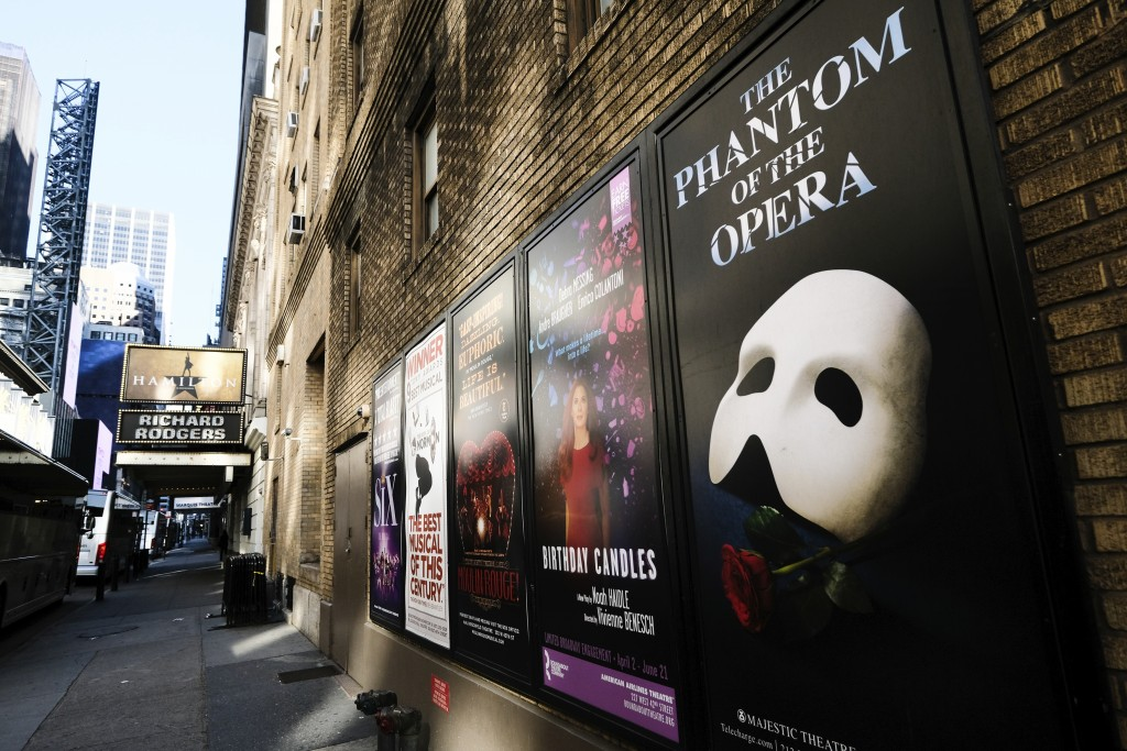 FILE - Broadway posters hang outside the Richard Rodgers Theatre during Covid-19 lockdown in New York on May 13, 2020. Many Broadway productions are s...