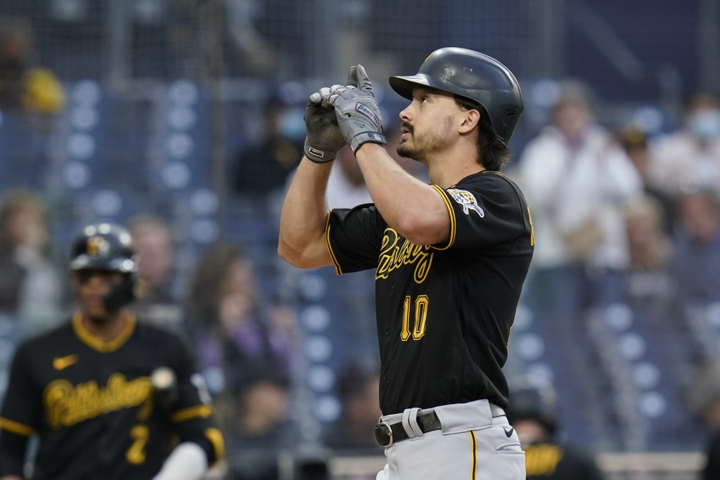 Pittsburgh Pirates' Bryan Reynolds gestures after hitting a home run during the sixth inning of the team's baseball game against the San Diego Padres,...