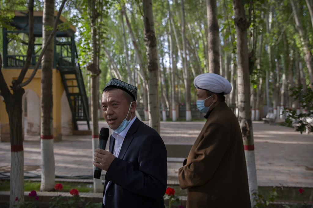 Mamat Juma, left, imam of the Id Kah Mosque, speaks to foreign journalists during a government organized visit at the mosque in Kashgar in western Chi...