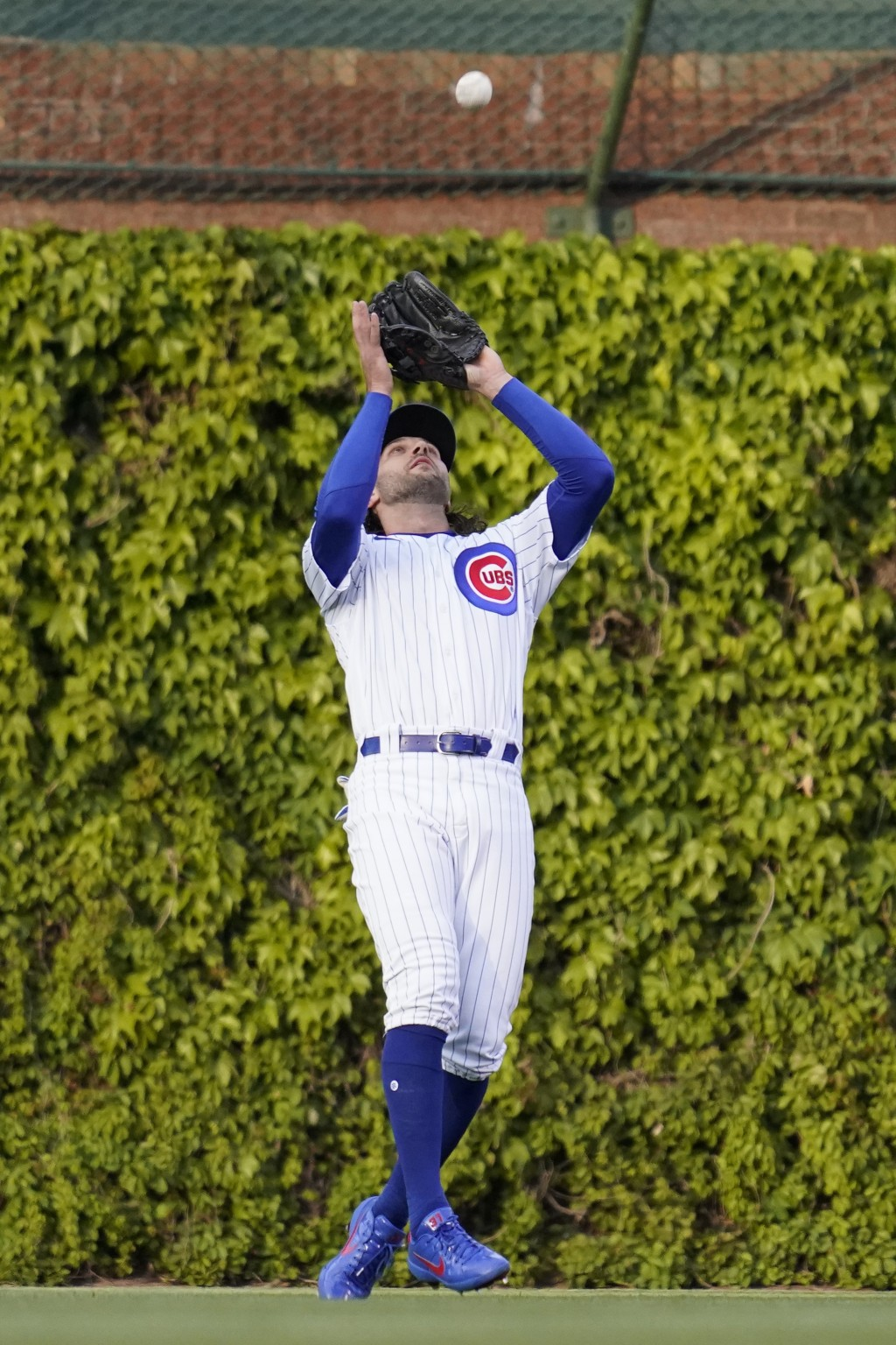 Chicago Cubs center fielder Jake Marisnick catches a fly ball by Los Angeles Dodgers' Corey Seager during the first inning of a baseball game in Chica...
