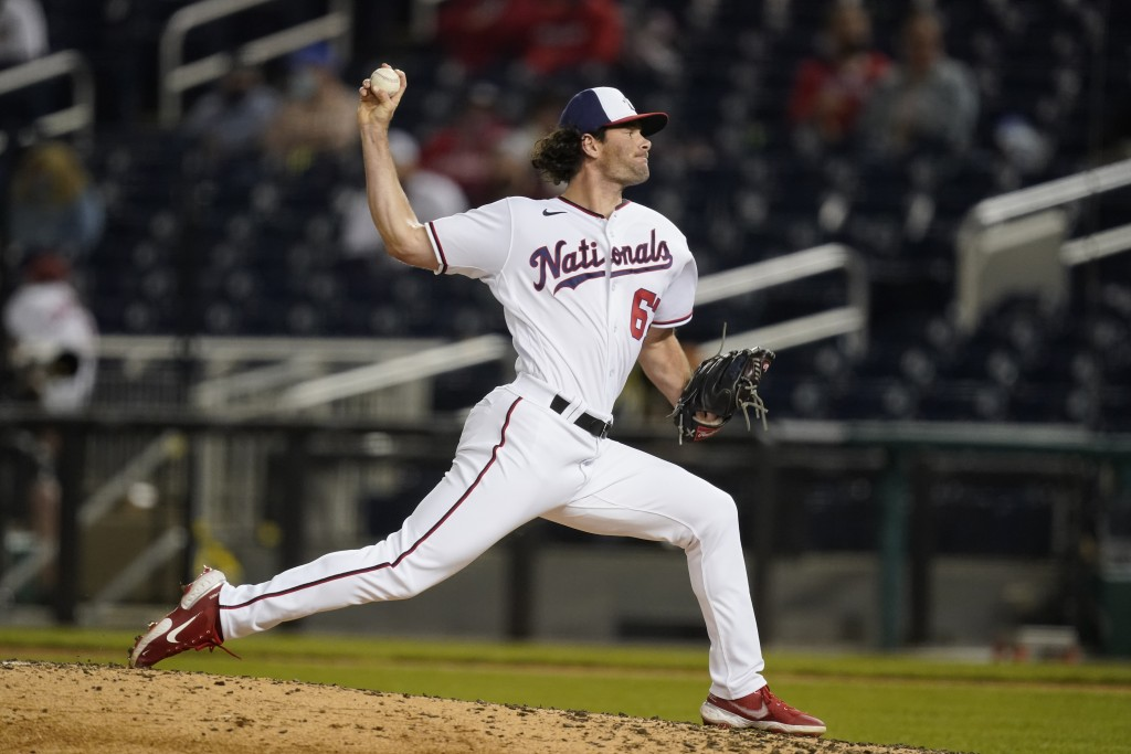 Washington Nationals pitcher Kyle Finnegan throws during the sixth inning of the team's baseball game against the Atlanta Braves at Nationals Park, We...