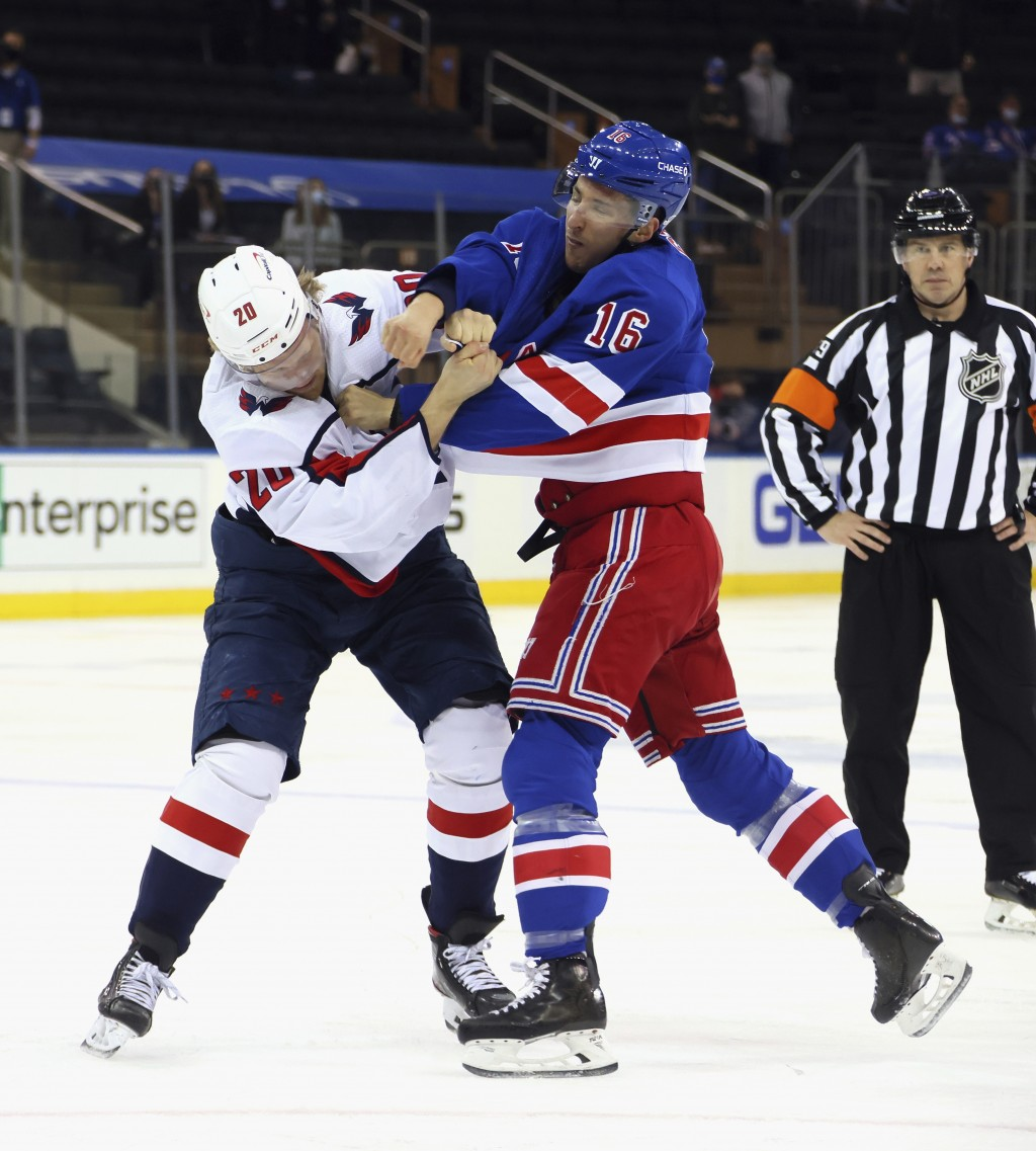 New York Rangers' Ryan Strome (16) fights with Washington Capitals' Lars Eller (20) during the first period of an NHL hockey game Wednesday, May 5, 20...