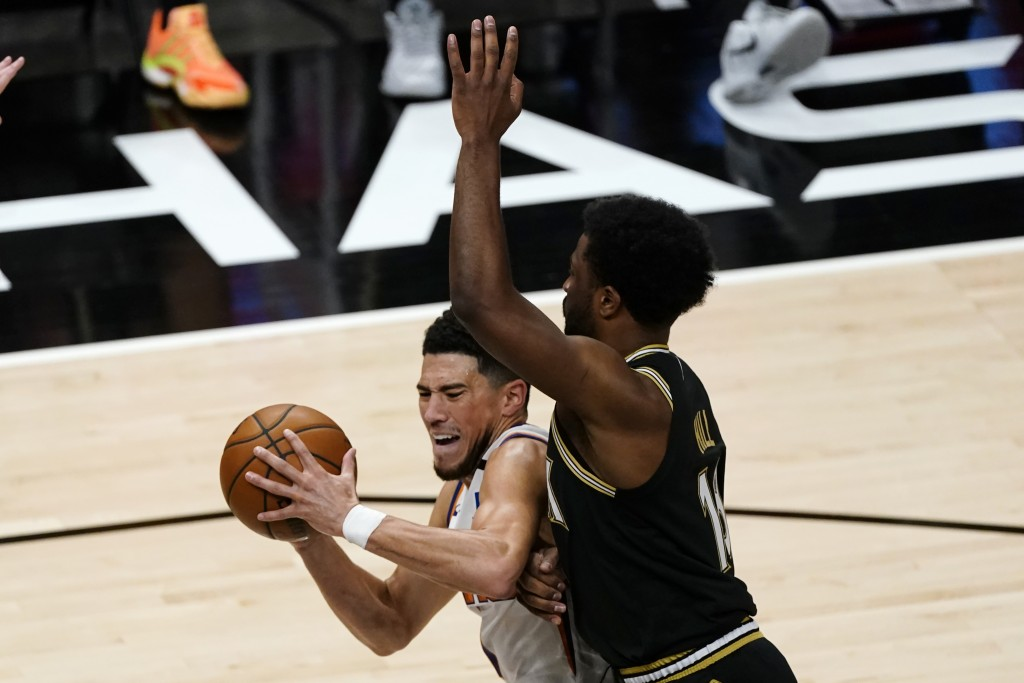 Phoenix Suns guard Devin Booker (1) drives against Atlanta Hawks forward Solomon Hill (18) in the first half of an NBA basketball game Wednesday, May ...