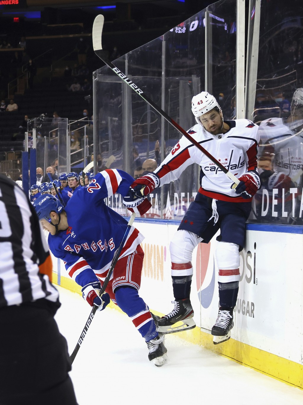 New York Rangers' Adam Fox (23) backs into Washington Capitals' Tom Wilson (43) during the first period of an NHL hockey game Wednesday, May 5, 2021, ...