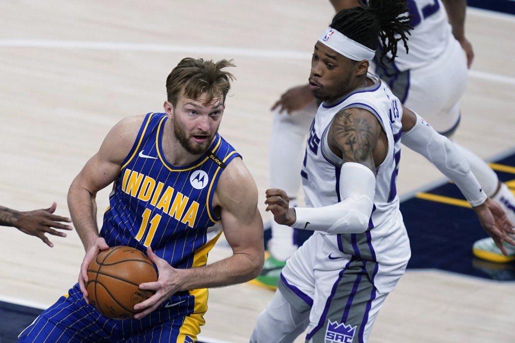 Indiana Pacers' Domantas Sabonis (11) goes to the basket against Sacramento Kings' Richaun Holmes (22) during the second half of an NBA basketball gam...