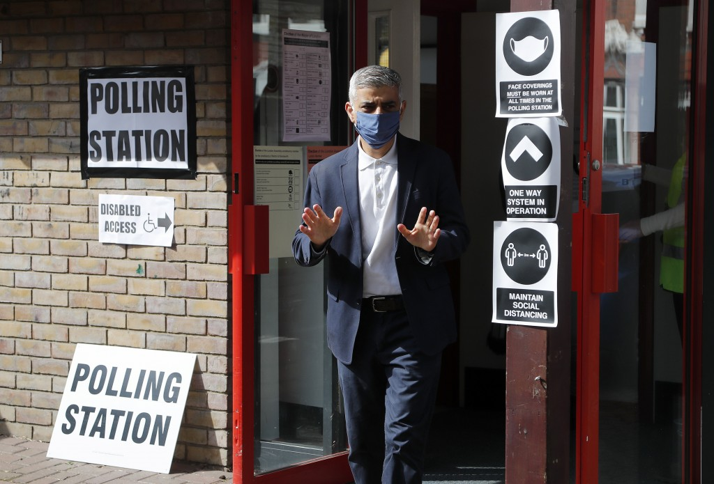 Mayor of London Sadiq Khan leave the polling station after casting his ballot, at St Albans Church in London, Thursday, May 6, 2021. Millions of peopl...