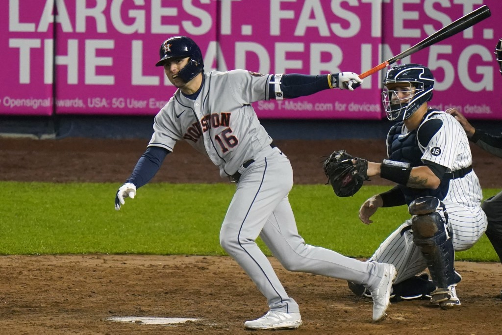 Houston Astros' Aledmys Diaz (16) follows through on a RBI double during the fourth inning of a baseball game Wednesday, May 5, 2021, in New York. (AP...