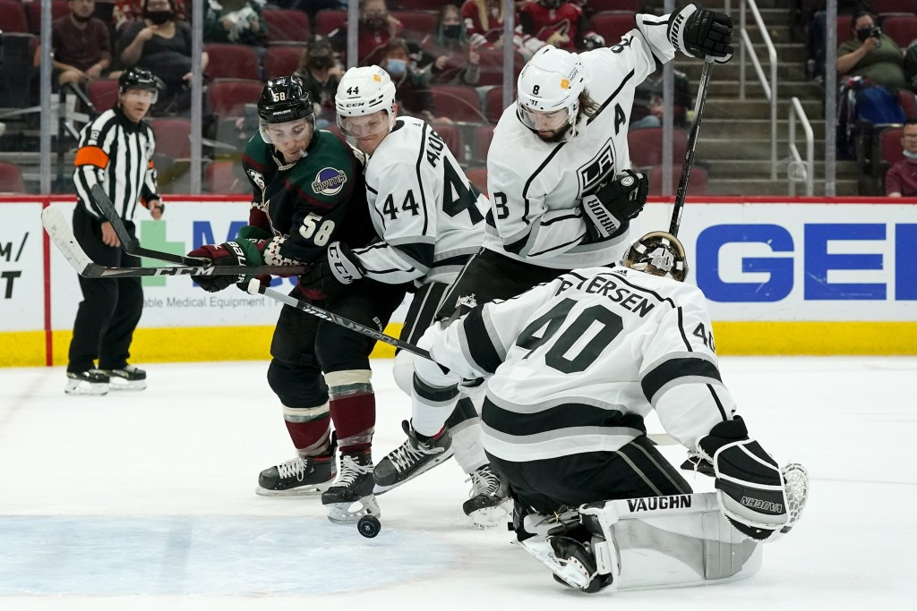 Arizona Coyotes' Jakob Chychrun, not seen, gets the puck past Los Angeles Kings goaltender Calvin Petersen (40) for a goal as Coyotes left wing Michae...