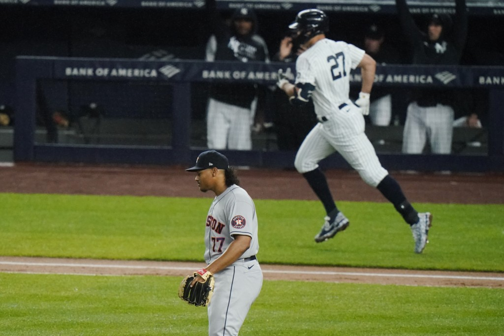 Houston Astros starting pitcher Luis Garcia (77) reacts as New York Yankees' Giancarlo Stanton (27) runs the bases after hitting a two-run home run du...
