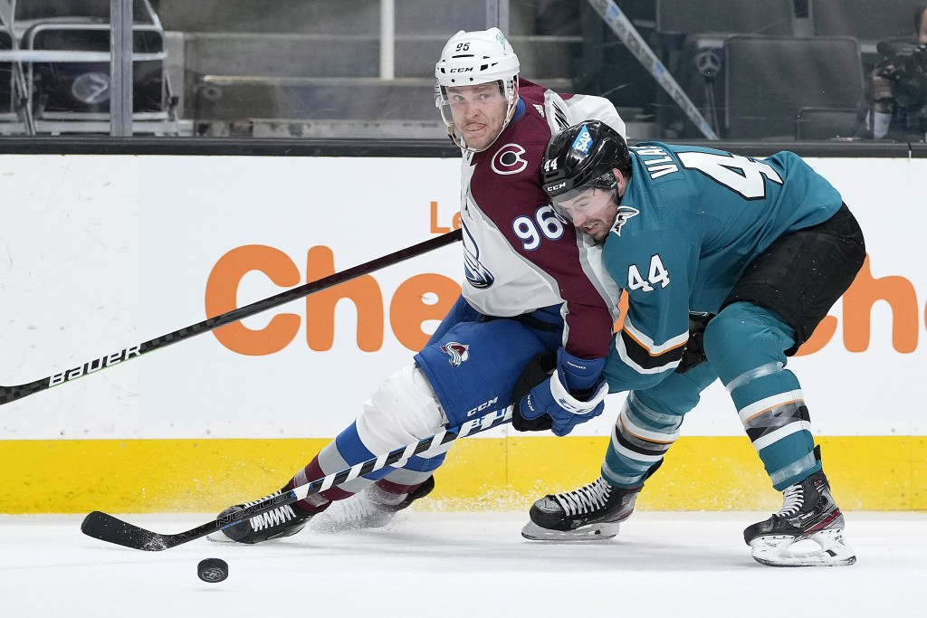 Colorado Avalanche right wing Mikko Rantanen (96) battles for the puck against San Jose Sharks defenseman Marc-Edouard Vlasic (44) during the second p...