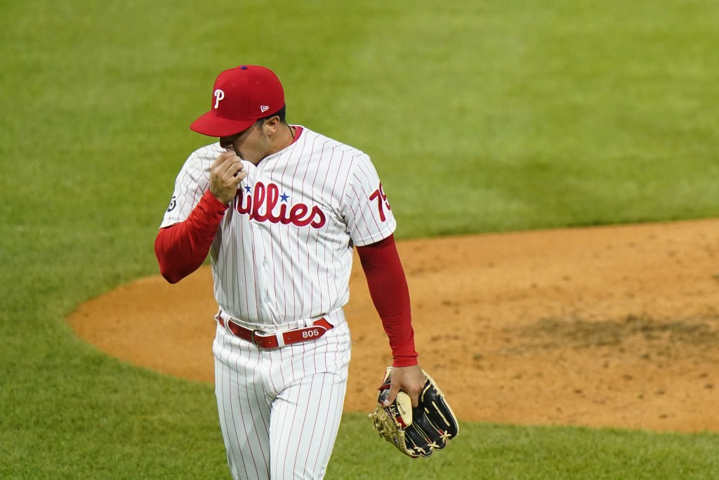 Philadelphia Phillies pitcher JoJo Romero wipes his face after being pulled during the fifth inning of baseball game against the Milwaukee Brewers, We...