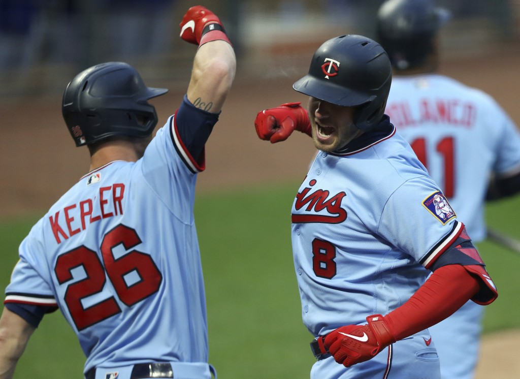 Minnesota Twins' Mitch Garver (8) celebrates with Max Kepler (26) after Garver hit a home run against the Texas Rangers during the second inning of a ...