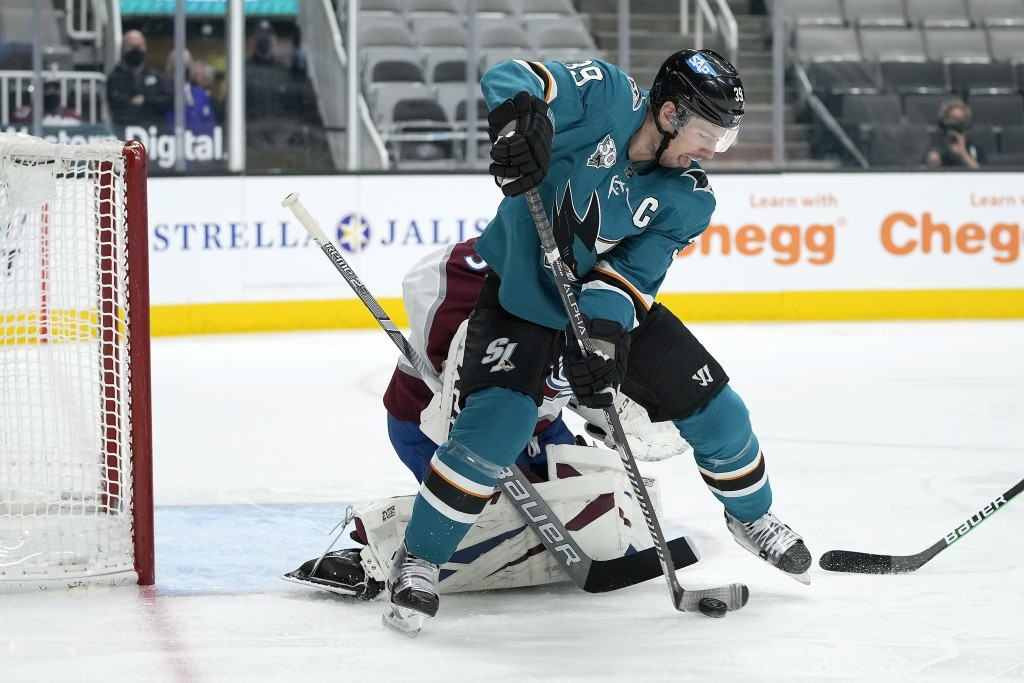 San Jose Sharks center Logan Couture (39) tries to score against Colorado Avalanche goaltender Philipp Grubauer (31) during the first period of an NHL...